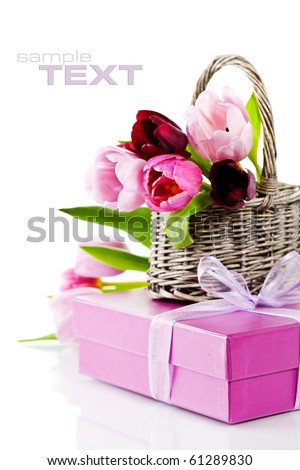 Pink tulips and gift box on a white background. With easy removable sample text. - stock photo
