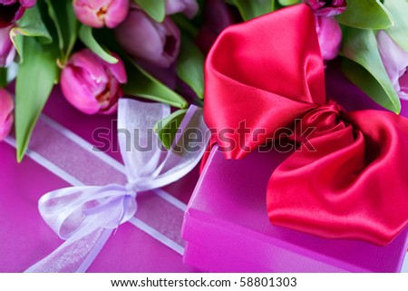 Pink tulips and gift boxes - stock photo