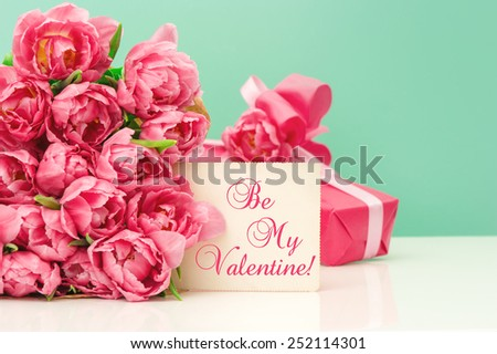 Pink tulips, gift and greetings card with sample text Be My Valentine! Valentine's Day concept - stock photo