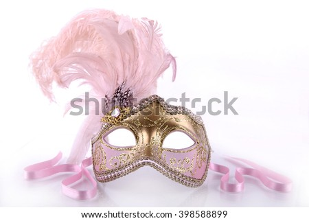 Pink venecian carnival mask on a white background. - stock photo
