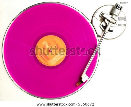 pink vinyl turning on turntable - stock photo