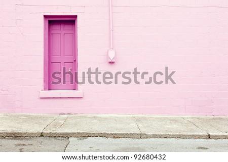 pink wall door sidewalk background - stock photo