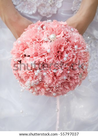 pink wedding bouquet at bride's hands - stock photo