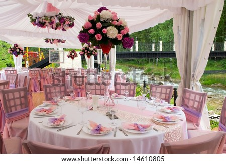 Pink wedding tables in outdoor restaurant - stock photo