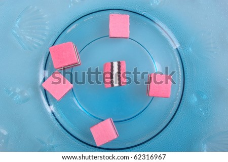 pink white and black licorice on plate - stock photo