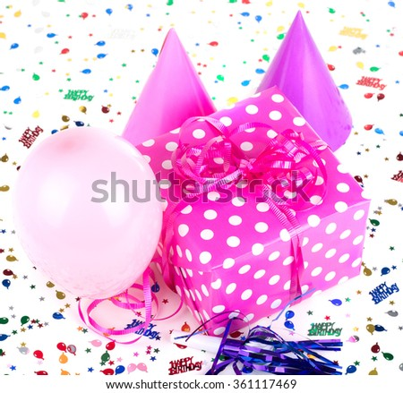 Pink with white polka dot birthday present and balloon and party hats