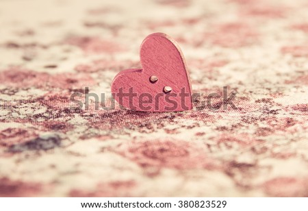 Pink wood sewing button scrap-booking heart shaped beautiful and delicate background of small flowers roses. The background can be used as greeting card, place for text - stock photo