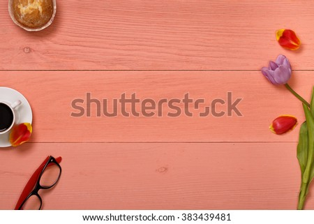 Pink wooden table, top view on workplace. Lilac tulips. Post blog social media 8 march. Banner template mockup for woman day. View from above with copy space for birthday. Mother day layout card. - stock photo