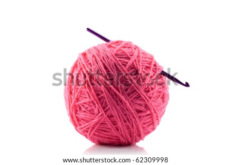 Pink yarn and crotchet hook isolated on white