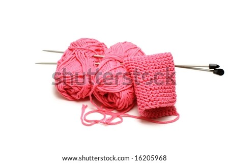 Pink yarn and some needles on white background - stock photo