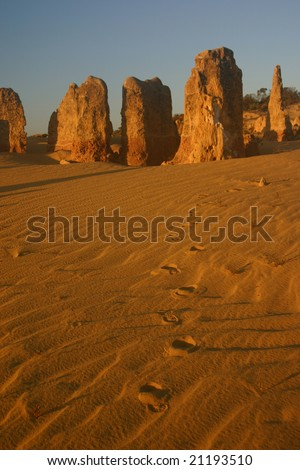 Pinnacles and footsteps, Cervantes, Western Australia - stock photo
