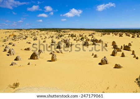 Pinnacles desert in Western Australia on sunny day with blue sky - stock photo