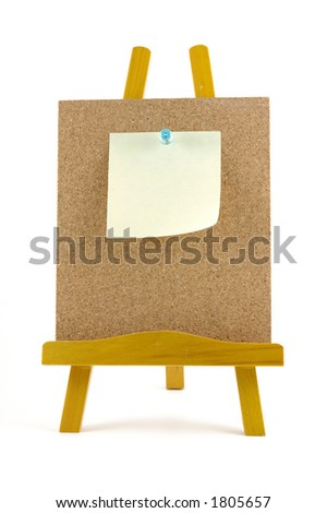 Pinned note on corkboard with wooden stand, isolated background