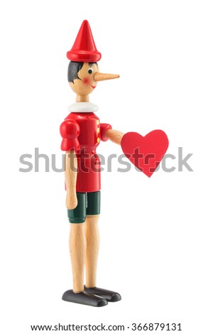 Pinocchio toy statue and heart isolated on white background. Valentineâ??s day concept. - stock photo