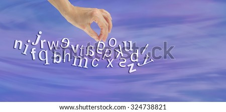 Pinpointing Dyslexia Website Banner -  female hand picking out a reversed G from a jumble of alphabet letters flowing across the  page symbolizing dyslexia  - stock photo