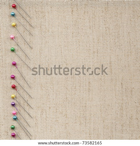 Pins on the background fabric - stock photo