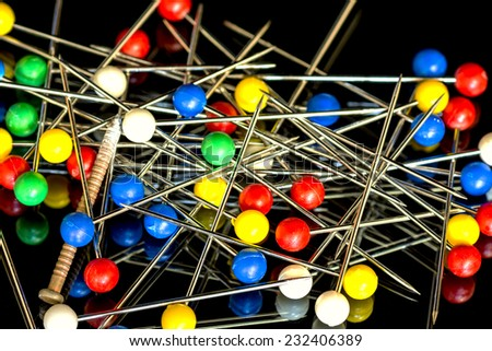 Pins with colored balls on the ends - stock photo