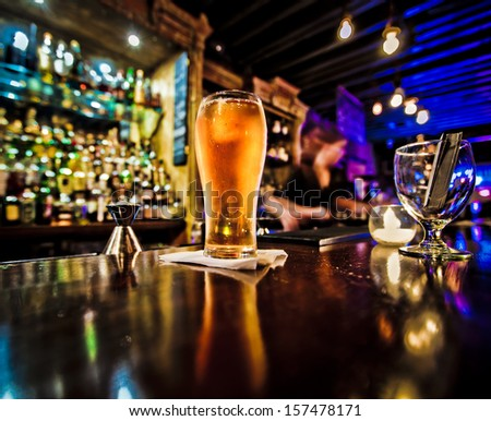 Pint of beer on a bar in a traditional style pub  - stock photo