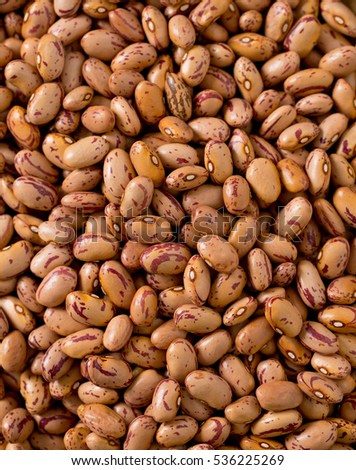 pinto beans on wooden surface