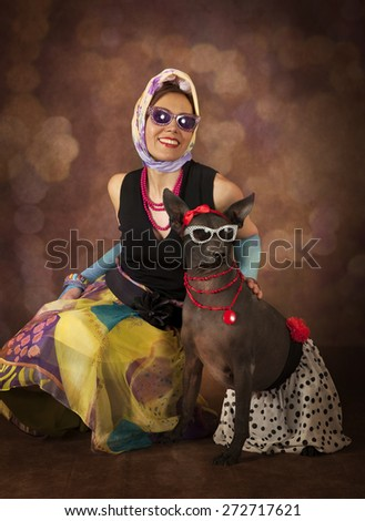 Pinup and Rockabilly styled woman with a dog - stock photo