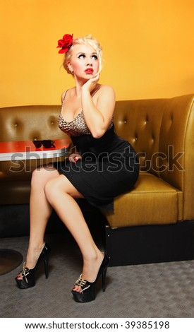 Pinup girl at a cafe - stock photo