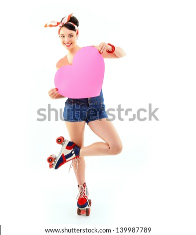 Pinup girl in retro roller skates holding big pink heart, full length portrait of young happy sexy woman in pin-up style in love, vintage stylization over white - stock photo