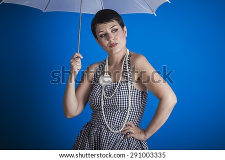 pinup girl style of the 50s with a white umbrella - stock photo