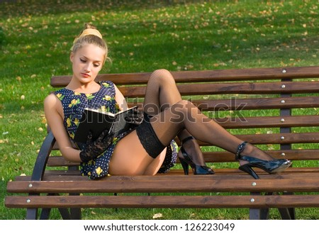 Pinup girl with book - stock photo
