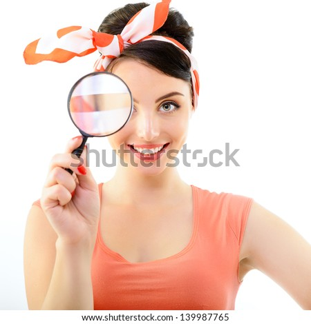 Pinup girl with magnifying glass, portrait of young happy sexy woman in pin-up style, over white - stock photo