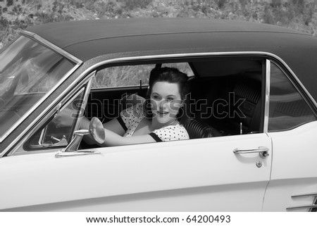 Pinup model and retro car, 1966 Mustang. - stock photo