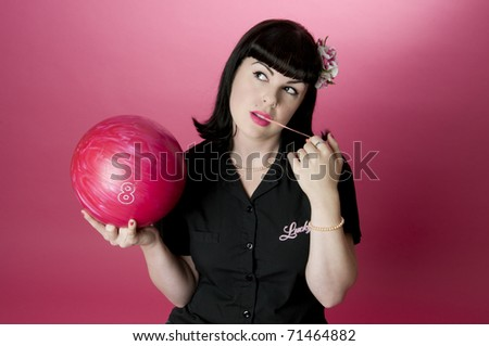 Pinup Model playing with bubble gum - stock photo