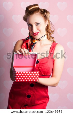 Pinup Woman In Valentine Romance Holding Present On Love Heart Background - stock photo