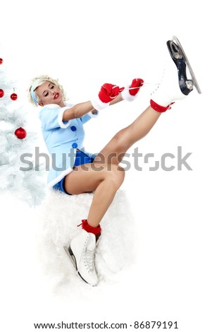 Pinup woman in winter style with skates. Isolated on white background - stock photo
