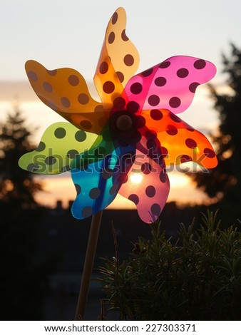 pinwheel against a nice sunset - stock photo