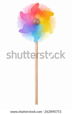 Pinwheel, colorful toy rotating on white - stock photo