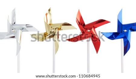 Pinwheel  silver, gold, red and blue on white background - stock photo