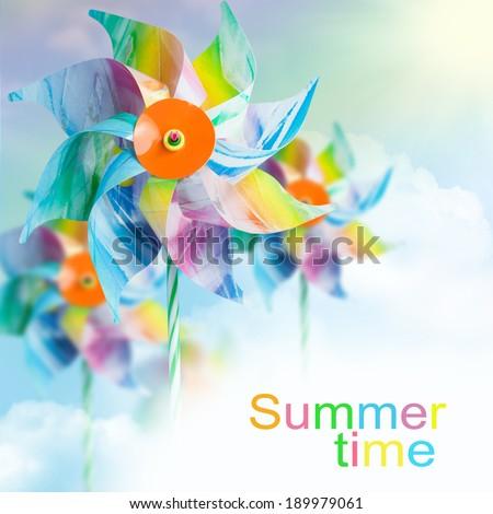 Pinwheels against a summer sky.   - stock photo