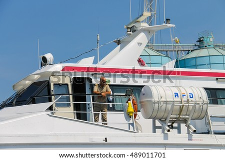 Piombino, Italy - June 30, 2015: Man on the deck of ferry boat Marmorica at berth in the seaport