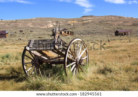 Pioneer coach now sits derelict and abandoned on a western prairie. - stock photo