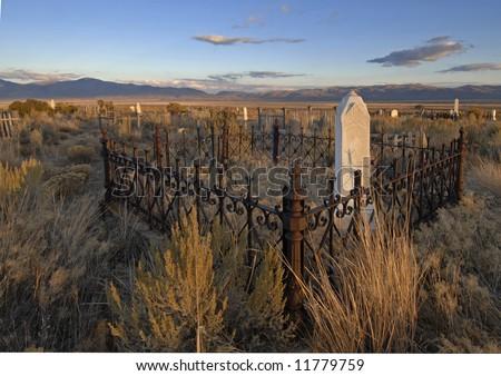 Pioneer graveyard in nameless ghost town in Nevada - stock photo