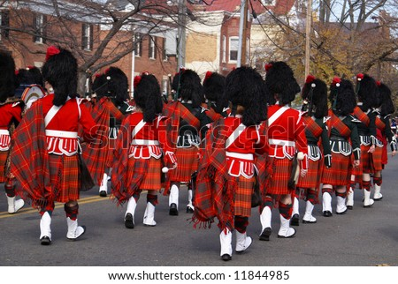 Pipe and drum band performing during annual Scottish Christmas Walk parade in City of Alexandria Old Town Washington DC area - stock photo