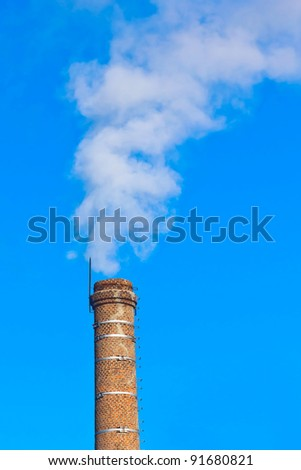 pipe ecology and smoke against the blue sky
