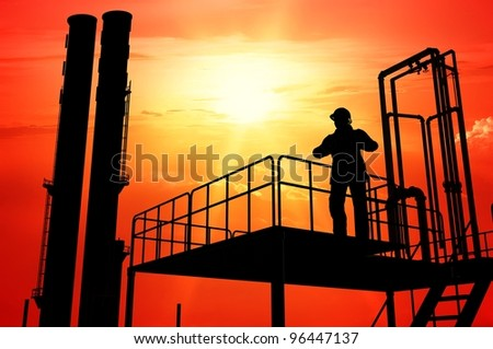 Pipe factory and working on a red background. - stock photo