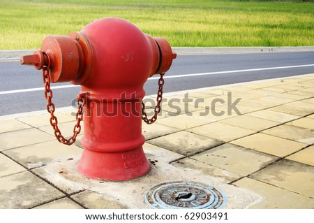 Pipe fittings in red street - stock photo