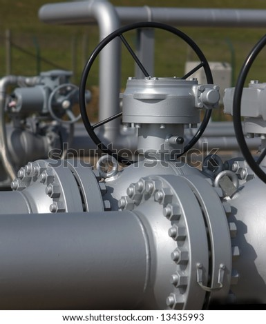 Pipe flanges and gas sensors of an LPG station. - stock photo