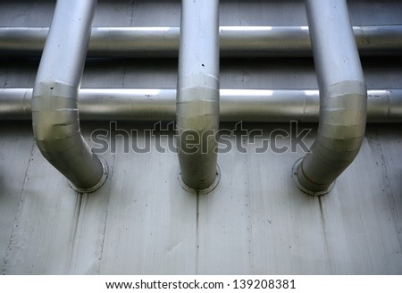 Pipe in the Powerhouse technology and energy industry for design - stock photo