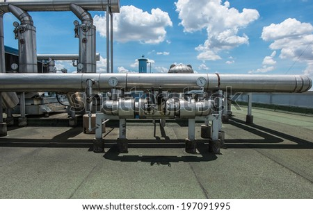 pipe line and valves with meter - stock photo