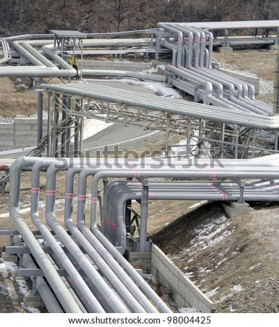 pipe line in petrochemical plant at winter - stock photo