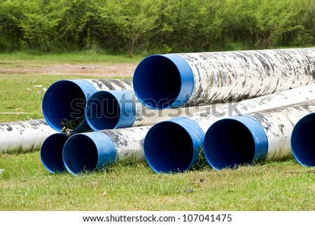 pipe line that laid through green field - stock photo