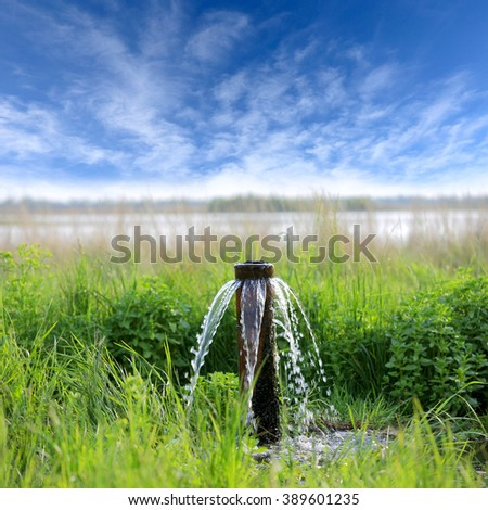 pipe of water source on meadow in steppe
